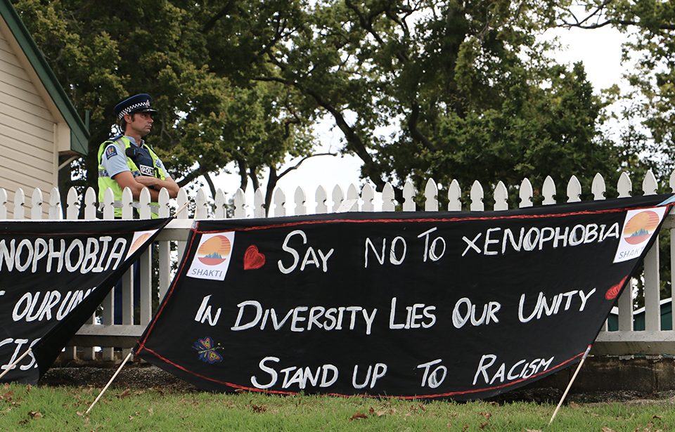 Speakers at the Auckland Domain vigil stand up against racism and xenophobia. Photo: Irra Lee