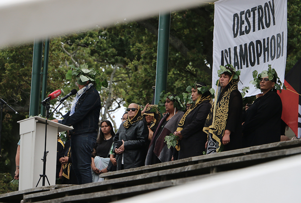 Sharon Hawke from Ngāti Whātua o Orākei takes a critical look at New Zealand's colonial past at Migrants Against Racism and Xenophobia-hosted vigil at Auckland Domain. Photo: Irra Lee